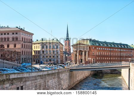 STOCKHOLM, SWEDEN - APRIL 14, 2010: View of Mynttorget Square. Located between Kanslihuset, Parliament and Royal Palace. On the background is The Riddarholmen Church, the burial of Swedish monarchs