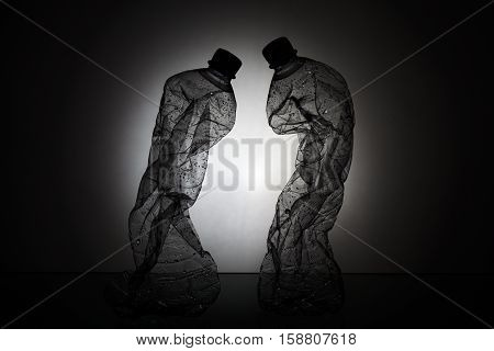 Silhouette of Two Crumpled Plastic Water Bottles