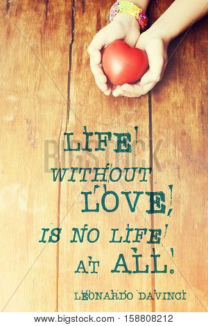 famous Leonardo Da Vinci quote about life without love printed over image with red heart in hands