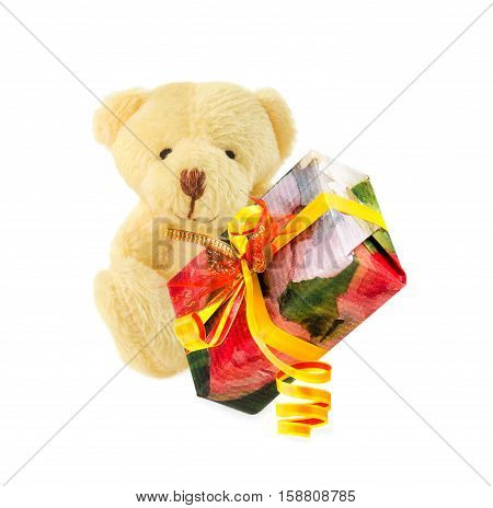 Teddy bear classic soft toy sitting with gift box on white background. Time to make gifts.