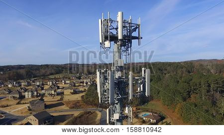 Aerial view of cell phone tower over neighborhood