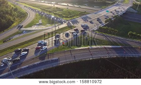 Busy freeway intersection from aerial drone perspective.