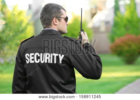 Male security guard in park