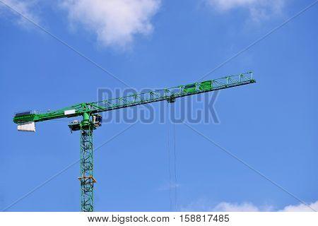Green crane in the Birmingham city center on the beautiful sky
