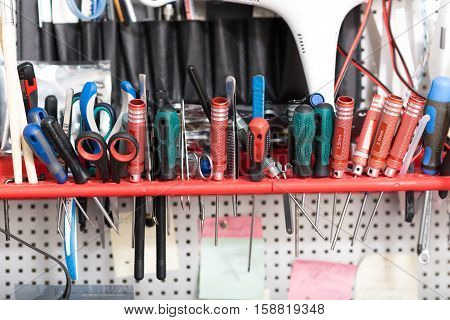 Repair equipment. Close up of pliers and screwdrivers on a table in a workroom