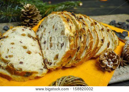 Fresh baked raisins bread sliced on granite board holiday concept