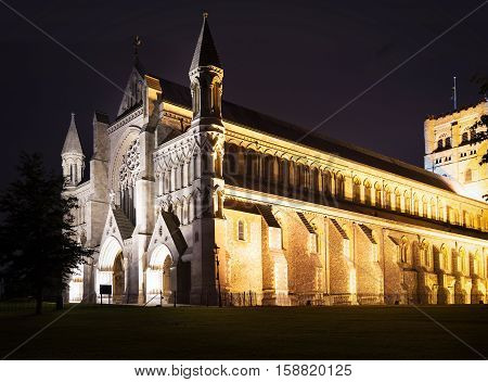 Popular tourist St Albans abbey church in night lights illumination in London, England, United Kingdom