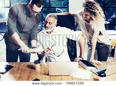 Concept of presentation new idea business project.Adult businessman discussing ideas with account director and creative manager in modern office.Horizontal, blurred background