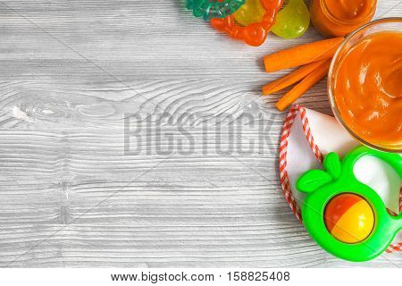 cooking vegetable puree for baby on wooden background top view.