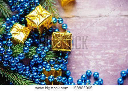 Gift boxes, fir tree branch and bijouterie