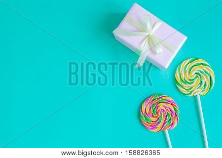 birth of child - lollipop on blue background top view