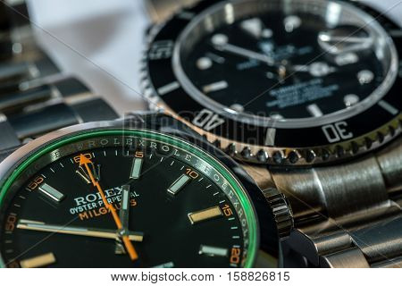 SAN MARINO- NOVEMBER 22 2016: A Rolex Milgauss and a Rolex Submariner in a macro view. Rolex was founded in 1909. It produces about 2000 luxury watches daily.