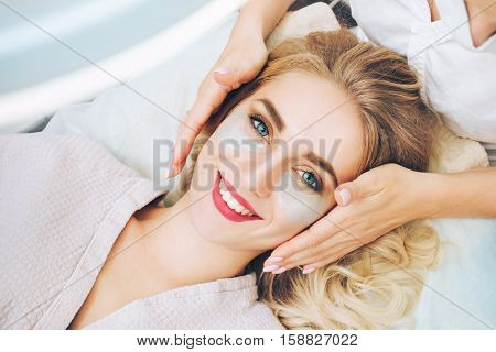 Cosmetologist applaying anti-aging eye gel pads. The concept of anti-aging