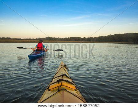 Two people kayaking, view from first kayak.