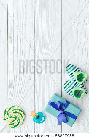 birth of child - lollipop on wooden background top view