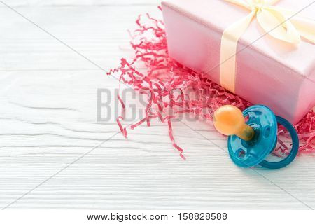gift for newborn baby on wooden background close up