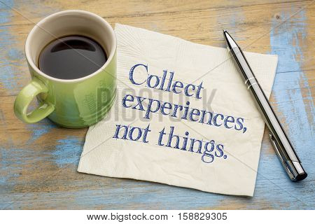 Collect experiences not things - words of inspiration on a napkin with a cup of coffee