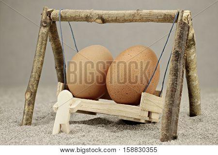 One wooden male let 2 huge eggs swing