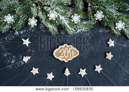 Christmas decorations, spruce branches on dark background top view - 2017