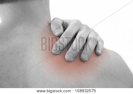 Man with pain shoulder. Pain in the human body. Black and white photo with red dot