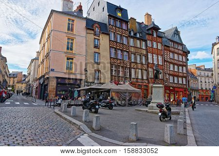 Rennes, France - May 7, 2012: Old houses at Champ Jacquet square in the city center of Rennes Brittany region France. People on the background.