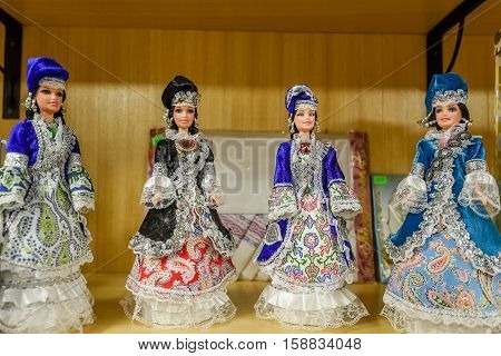 Collection of souvenir dolls in traditional tatar dresses on marketplace