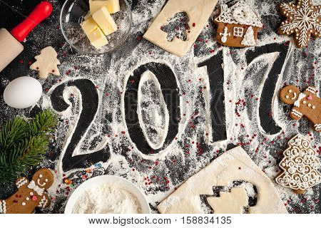 cooking christmas gingerbread on wooden background top view 2017 new year.