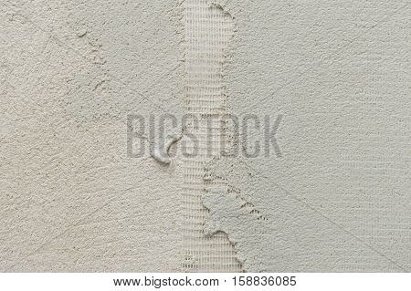 close-up of microcement thick preparation layers on wall covering microtopping coating whit fiberglass mesh