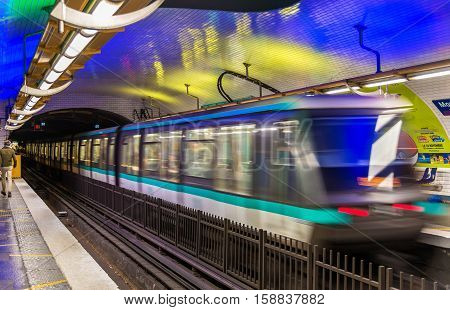 Paris, France - October 9, 2016: Metro train leaving Montparnasse - Bienvenue station. Paris Metro is one of biggest metro systems in the world