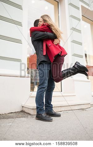 Euphoric Young Couple Meeting And Hugging On The Street.