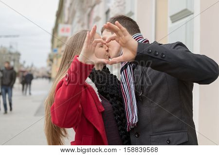 Closeup Of Couple Making Heart Shape With Hands. Winter Time.