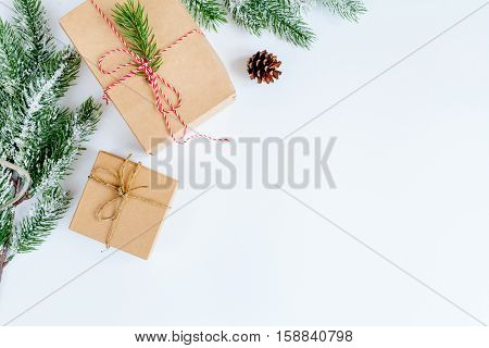 packaging christmas gifts in boxes on white background top view.