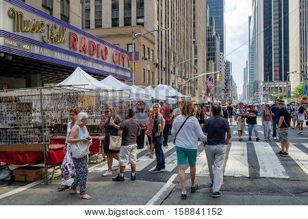 NEW YORK,USA - AUGUST 20,2016 : Traditional street fair at 6th Avenue next to the Radio City Music Hall in New York City
