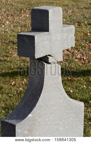 Broken and repaired Christian cross old granite gravestone