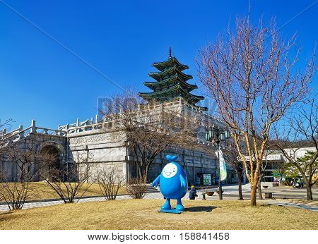 Seoul South Korea - March 11 2016: National Folk Museum of Korea in Gyeongbokgung Palace in Seoul South Korea. People in the street