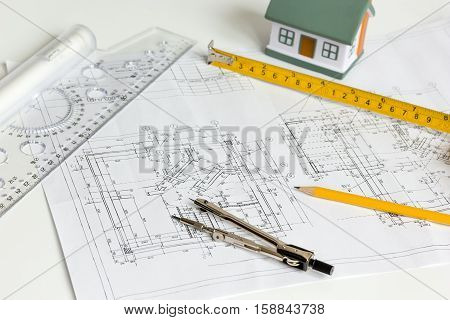 architect tools on white background with drawings apartments top view.