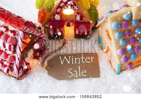 Label With English Text Winter Sale. Colorful Gingerbread House On Snow And Snowflakes. Christmas Card For Seasons Greetings