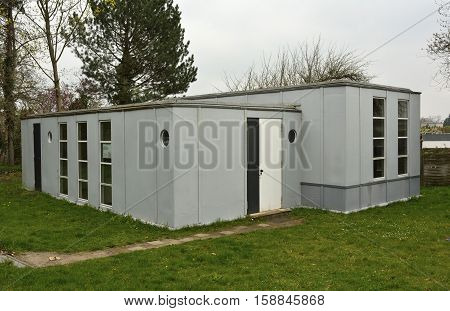 Dessau-Rosslau, Germany - April 14, 2016. Steel House, designed by Muche-Paulick in 1926-27, at Sudstrasse street in Torten Estate district of Dessau-Rosslau, with grass lawn.