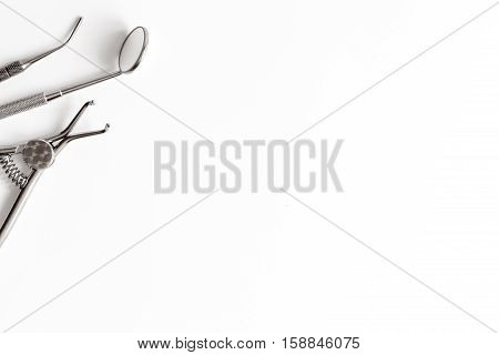 dental tools on white background top view.