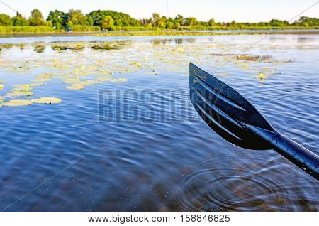 oar over water surface on river