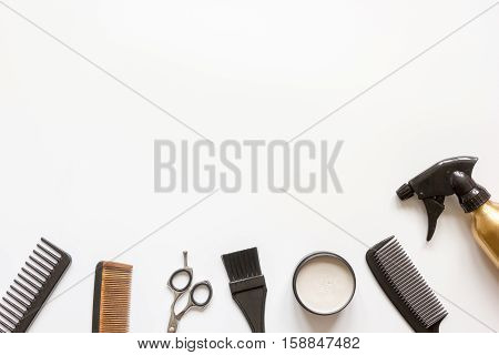 Tools for hair styling on white background top view.