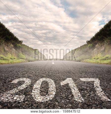 year 2017 painted on asphalt road