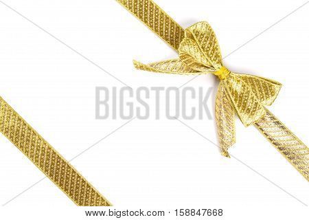 christmas gold bow isolated on white. holiday concept