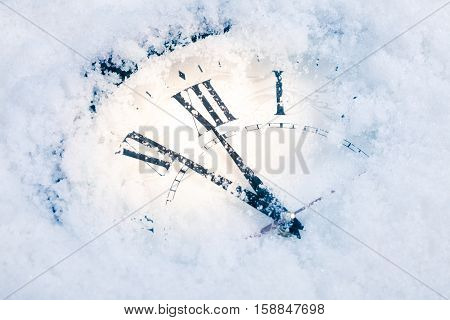 Christmas Time Clock under snow. studio shot