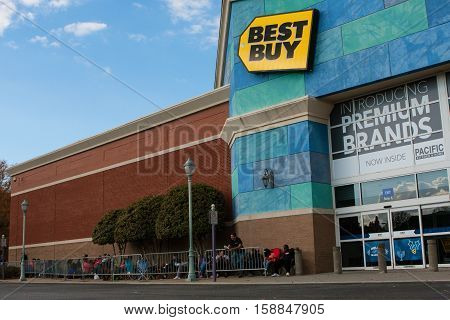 BUFORD, GA - NOVEMBER 2016:  Customers line up behind a barrier on Thanksgiving day as they wait for Black Friday shopping to begin at Best Buy in Buford GA on November 24 2016.
