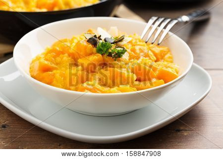 risotto with red hokkaido squash fresh herbs and parmesan cheese.