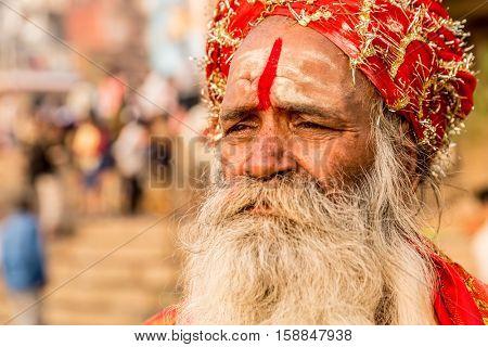 Hindu sadhu holy man near the Ganges river in Varanasi, India
