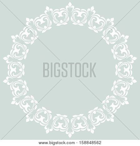 Oriental round frame with arabesques and floral elements. Floral fine border. Greeting card with place for text. Light blue and white pattern