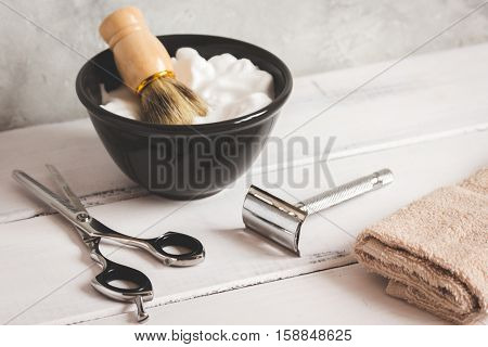 Wooden desktop with tools for shaving beards close up