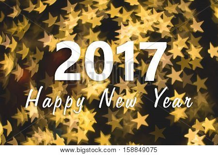 2017 Happy New Year background with golden star bokeh